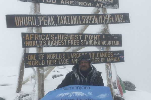 Byron reaches the top of the Kilimanjaro summit.